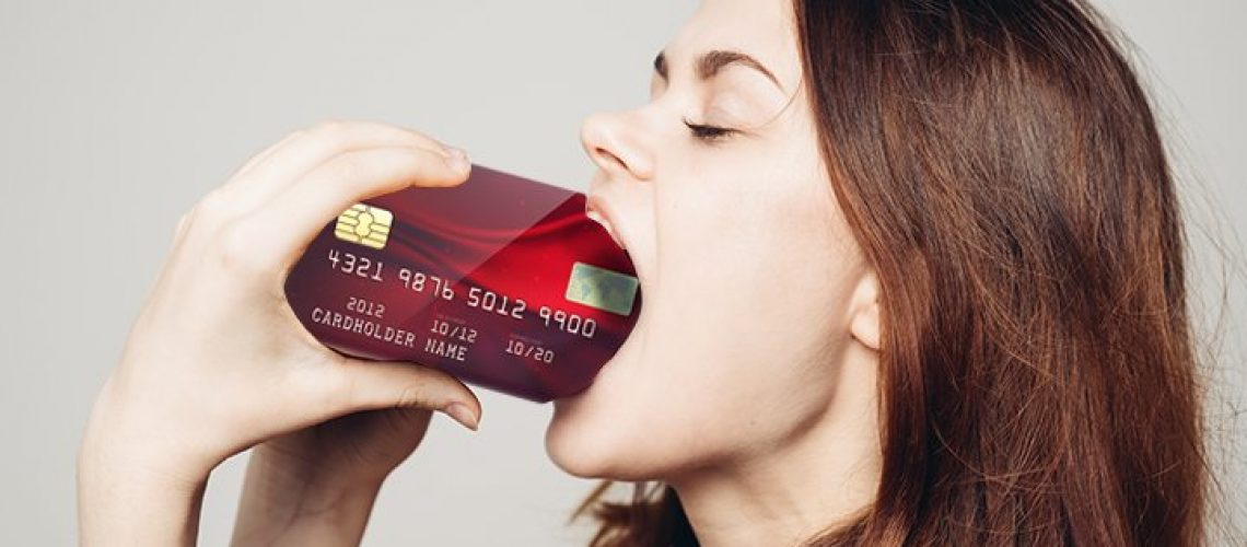 woman eating drinking credit card of plastic microplastic